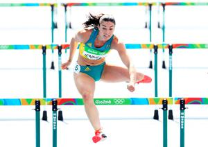 RIO DE JANEIRO, BRAZIL - AUGUST 16:  Michelle Jenneke of Australia competes during the Women's 100m Hurdles Round 1 - Heat 2 on Day 11 of the Rio 2016 Olympic Games at the Olympic Stadium on August 16, 2016 in Rio de Janeiro, Brazil.  (Photo by Paul Gilham/Getty Images)