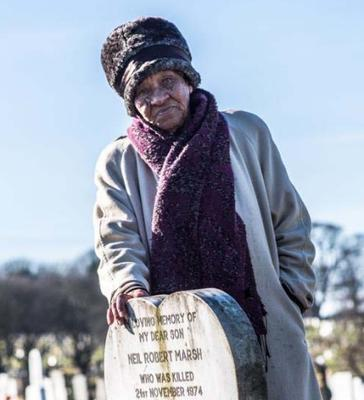 """Hilda Marsh, at the grave-side of her son Neil """"Tommy"""" March. He was the bombing's youngest victim. (Family/PA)"""