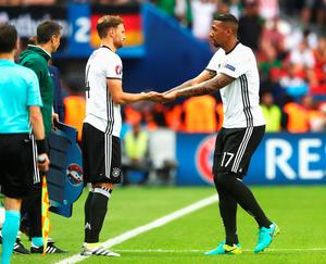 PARIS, FRANCE - JUNE 21:  Jerome Boateng (1st R) of Germany is replaced by Benedikt Hoewedes (2nd R) during the UEFA EURO 2016 Group C match between Northern Ireland and Germany at Parc des Princes on June 21, 2016 in Paris, France.  (Photo by Alexander Hassenstein/Getty Images)