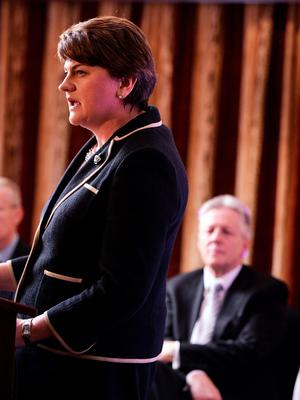 BELFAST, NORTHERN IRELAND - DECEMBER 17:  The new DUP leader Arlene Foster (L) addresses the media and party colleagues watched by Peter Robinson (R) at the Park Avenue hotel after the Democratic Unionist Party electoral college meeting on December 17, 2015 in Belfast, Northern Ireland. Arlene Foster succeeds Peter Robinson and becomes the first female leader of the Democratic Unionist Party. No other nominations were put forward for the role of leader. Mrs Foster will also be appointed as the new Northern Ireland first minister in the coming weeks. The former Ulster Unionist Party member has enjoyed a rapid rise through the ranks of the DUP following her defection in 2004, twice standing in as temporary first minister for Peter Robinson in times of personal and political crisis. The DUP remain the largest political party within the provinces' Executive government.  (Photo by Charles McQuillan/Getty Images)