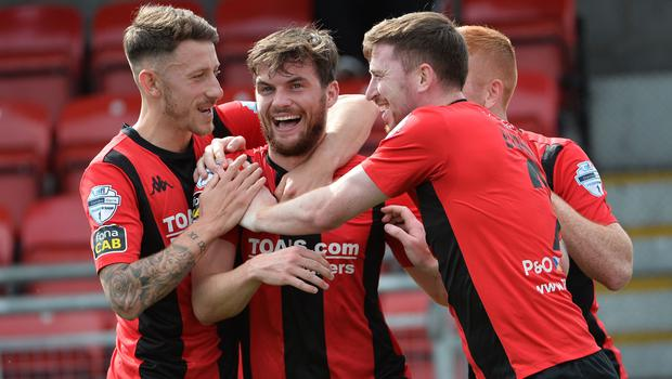 Philip Lowry celebrates his early opener for Crusaders