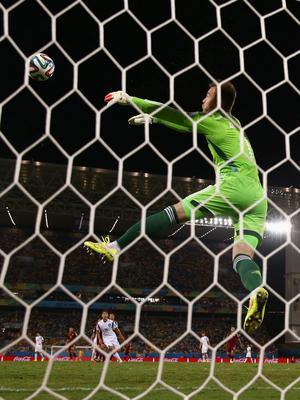 Igor Akinfeev of Russia makes a save during the 2014 FIFA World Cup Brazil Group H match between Russia and South Korea at Arena Pantanal on June 17, 2014 in Cuiaba, Brazil.  (Photo by Warren Little/Getty Images)