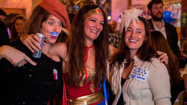 LONDON, ENGLAND - NOVEMBER 08:  Democrats dress up including Wonder Woman at the Democrats Abroad US election night party at Marylebone Sports Bar and Grill on November 8, 2016 in London, England. Americans have gone to the polls today, November 8, to elect the 45th President of the United States. Democratic presidential candidate Hillary Clinton, if elected, would be the first woman president in American history. Clinton is running against Republican presidential candidate Donald Trump. (Photo by Chris J Ratcliffe/Getty Images)