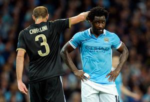 Manchester City's Ivorian striker Wilfried Bony (R) reacts after missing a shot on goal during a UEFA Champions League group stage football match between Manchester City and Juventus at the Etihad stadium in Manchester, north-west England on September 15, 2015.       AFP PHOTO / OLI SCARFFOLI SCARFF/AFP/Getty Images