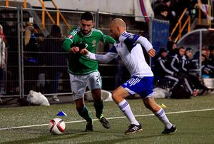 Northern Ireland's Conor McLaughlin (left) and Faroe Islands' Christian Holst battle for the ball during the UEFA European Championship Qualifying match at the Torsvollur, Torshavn. Picture date: Friday September 4, 2015. See PA story SOCCER Faroe Islands. Photo credit should read: John Walton/PA Wire.