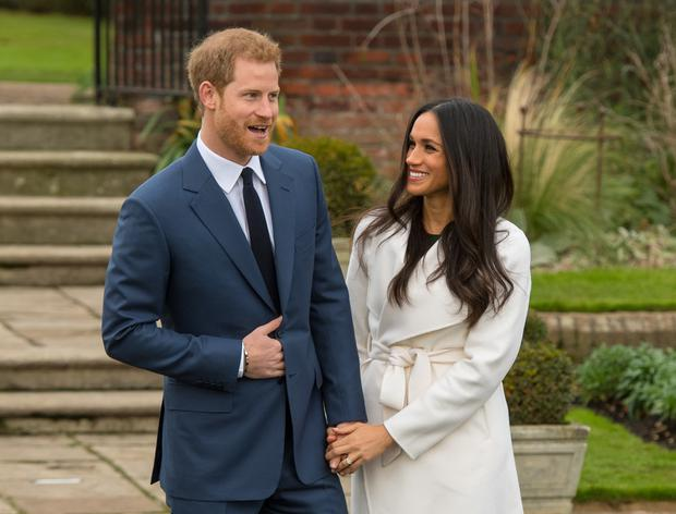 Prince Harry and Meghan Markle in the Sunken Garden at Kensington Palace after the announcement of their engagement (Dominic Lipinski/PA)
