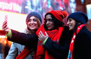 The beautiful game - football fans from around the world -  Liverpool fans take a selfie prior to the Premier League match between Liverpool and Swansea City at Anfield on December 26, 2017 in Liverpoo