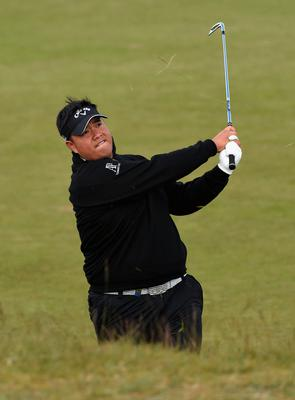 NEWCASTLE, NORTHERN IRELAND - MAY 29:  Kiradech Aphibarnrat of Thailand hits his 2nd shot on the 13th hole during the Second Round of the Dubai Duty Free Irish Open Hosted by the Rory Foundation at Royal County Down Golf Club on May 29, 2015 in Newcastle, Northern Ireland.  (Photo by Ross Kinnaird/Getty Images)