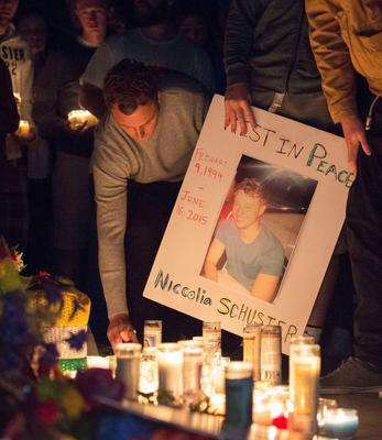 People place candles and signs at a memorial for those who lost their lives after a balcony gave way in Berkeley, California on June 17, 2015.  Dry rot and overcrowding could be responsible for the collapse of a balcony at a California apartment building, sending five Irish citizens and an Irish-American woman plummeting to their deaths, media reports said on June 17.  At least seven other people were injured in the accident in Berkeley, which took place in the early hours of June 16 during a 21st birthday party.      AFP PHOTO / JOSH EDELSONJosh Edelson/AFP/Getty Images