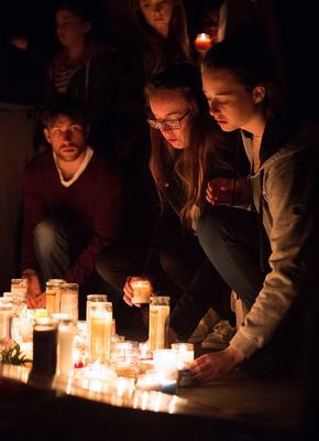 People place candles at a memorial for those who lost their lives after a balcony gave way in Berkeley, California on June 17, 2015.  Dry rot and overcrowding could be responsible for the collapse of a balcony at a California apartment building, sending five Irish citizens and an Irish-American woman plummeting to their deaths, media reports said on June 17.  At least seven other people were injured in the accident in Berkeley, which took place in the early hours of June 16 during a 21st birthday party.      AFP PHOTO / JOSH EDELSONJosh Edelson/AFP/Getty Images