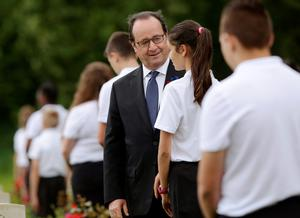 THIEPVAL, FRANCE - JULY 1: French President Francois Hollande meets British and French school children during the Commemoration of the Centenary of the Battle of the Somme at the Commonwealth War Graves Commission Thiepval Memoria on July 1, 2016 in Thiepval, France. The event is part of the Commemoration of the Centenary of the Battle of the Somme at the Commonwealth War Graves Commission Thiepval Memorial in Thiepval, France, where 70,000 British and Commonwealth soldiers with no known grave are commemorated. (Photo bt Yui Mok - Pool/Getty Images)