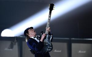 Angus Young of AC/DC performs at the 57th annual Grammy Awards on Sunday, Feb. 8, 2015, in Los Angeles. (Photo by John Shearer/Invision/AP)