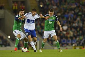PACEMAKER BELFAST   08/10/2016 Northern Ireland v San Marino World Cup Qualifier Group C Northern Ireland's Conor McLaughlin and Oliver Norwood with  Luca Tosi of San Marino during this evenings game at the National Stadium in Belfast. Photo Mark Marlow/Pacemaker Press