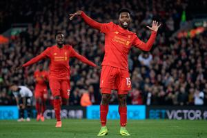 Liverpool's English striker Daniel Sturridge (R) celebrates after scoring their second goal during the EFL (English Football League) Cup fourth round match between Liverpool and Tottenham Hotspur at Anfield in Liverpool north west England on October 25, 2016. AFP/Getty Images