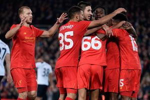 Liverpool's English striker Daniel Sturridge (R) celebrates with teammates after scoring their second goal during the EFL (English Football League) Cup fourth round match between Liverpool and Tottenham Hotspur at Anfield in Liverpool north west England on October 25, 2016. AFP/Getty Images