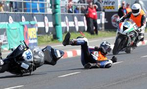 Chris Dixon crashes to the ground behind Dave Walsh as Alan Brown tries to avoid him during the Supersport practice at the Vauxhall International North West 200 today.  PICTURE BY STEPHEN DAVISON