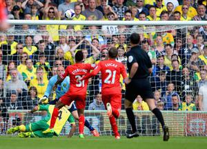 NORWICH, ENGLAND - APRIL 20:  Raheem Sterling of Liverpool scores their third goal during the Barclays Premier League match between Norwich City and Liverpool at Carrow Road on April 20, 2014 in Norwich, England.  (Photo by Michael Regan/Getty Images)