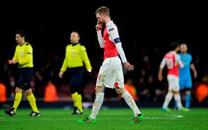 Arsenal's German defender Per Mertesacker leaves the pitch follwing the UEFA Champions League round of 16 1st leg football match between Arsenal and Barcelona at the Emirates Stadium in London on February 23, 2016.   Barcelona won the match 2-0. / AFP / JAVIER SORIANOJAVIER SORIANO/AFP/Getty Images