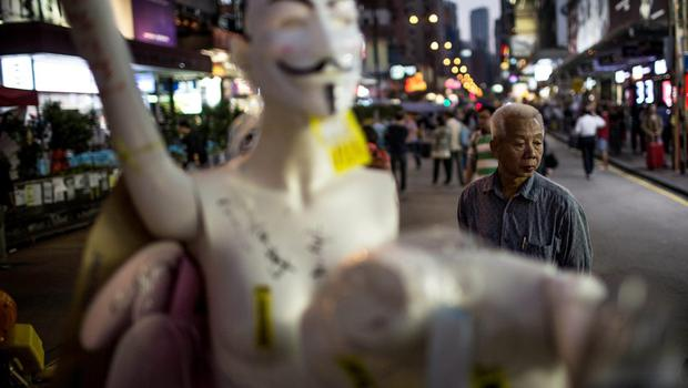 A man looks at mannequins built into a barricade setup by pro-democracy activists on a street in Mong Kok District on November 24, 2014 in Hong Kong. The Mong Kok protest site is scheduled for clearance by baliffs this week after Hong Kong's high court authorized police to arrest protesters who obstruct bailiffs on the three interim restraining orders.  (Photo by Chris McGrath/Getty Images)