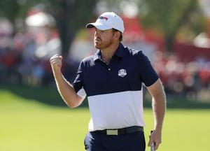 United States' J.B. Holmes reacts after winning the second hole during a singles match at the Ryder Cup golf tournament Sunday, Oct. 2, 2016, at Hazeltine National Golf Club in Chaska, Minn. (AP Photo/Charlie Riedel)