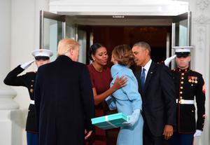 US President Barack Obama(R) and First Lady Michelle Obama(2nd-L) welcome Preisdent-elect Donald Trump(L) and his wife Melania(2nd-R) to the White House in Washington, DC January 20, 2017.  / AFP PHOTO / JIM WATSONJIM WATSON/AFP/Getty Images