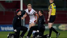 Precaution: Ulster's Stuart Olding briefly leaves field after a head injury in Thomond Park defeat
