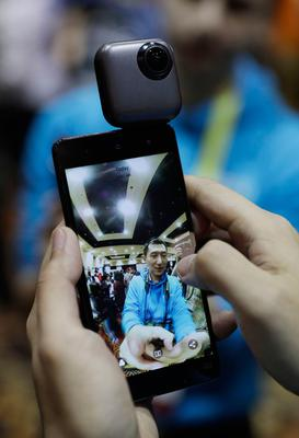 An employee uses a PTU 360 degree spherical camera during CES Unveiled before CES International, Tuesday, Jan. 3, 2017, in Las Vegas. (AP Photo/John Locher)