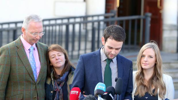 Daniel McArthur of Ashers with his wife Amy and parents pictured leaving the High Court in Belfast after the judgement was given.  Picture by Jonathan Porter/Press Eye