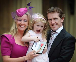 Investitures at Buckingham Palace...LONDON - JUNE 28: Jockey Tony McCoy poses with his wife Chanelle and daughter Eve after he received his OBE which he received from Queen Elizabeth IIat Buckingham Palace June 28, 2011 in London, England. (Photo by Stefan Rousseau - WPA Pool/Getty Images)...S