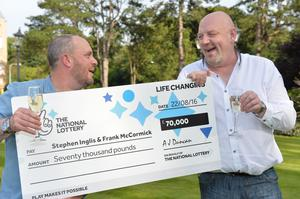 NEVER BIN BETTER:  County Down bin men Frank McCormick(44) from Newtownards and Stephen Inglis (46) from Bangor celebrate their wheelie good fortune after collecting a tasty £70,000 from a National Lottery collecting a tasty £70,000 from a National Lottery Scratchcard.