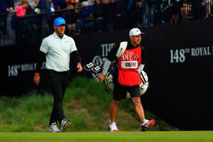 PORTRUSH, NORTHERN IRELAND - JULY 19: Brooks Koepka of the United States walks on the 1st hole with his caddie, Ricky Elliot during the second round of the 148th Open Championship held on the Dunluce Links at Royal Portrush Golf Club on July 19, 2019 in Portrush, United Kingdom. (Photo by Mike Ehrmann/Getty Images)