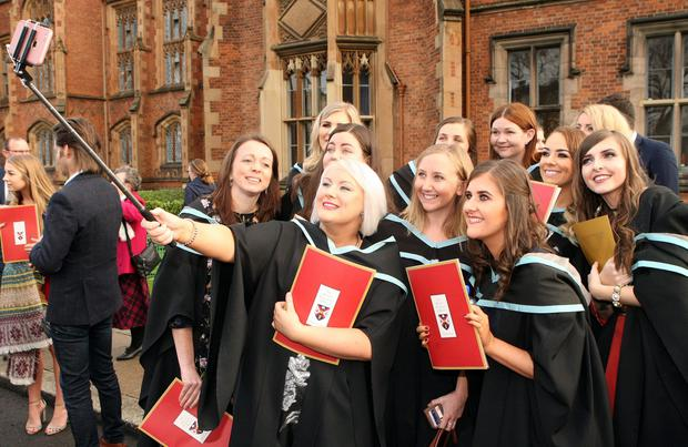 Mandatory Credit - Picture by Freddie Parkinson/Press Eye © Thursday 8th December 2016 Graduations take place at Queens University in Belfast. Laura Smith from Ballymoney tahke a selfie with her fellow Mid-Wives
