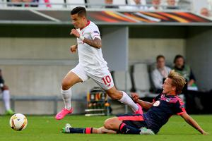 BORDEAUX, FRANCE - SEPTEMBER 17: Philippe Coutinho for Liverpool FC is tackled by Clement Chantome for FC Girondins de Bordeaux during the Europa League game between FC Girondins de Bordeaux and Liverpool FC at Matmut Atlantique Stadium on September 17, 2015 in Bordeaux, France.  (Photo by Romain Perrocheau/Getty Images)