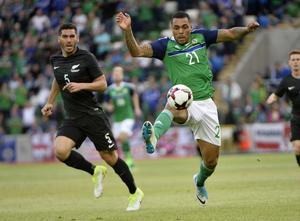 Press Eye - Belfast - Northern Ireland 2nd  June  2017 - Picture by Stephen Hamilton / Press Eye. Friendly International match between Northern Ireland and New Zealand at the National Stadium in Belfast.  Northern Irelands Josh Magennis in action with New Zealands Michael Boxall
