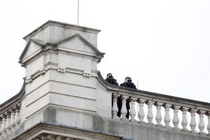 Police overlook the scene before the annual Remembrance Sunday service at the Cenotaph memorial in Whitehall. Gareth Fuller/PA Wire.