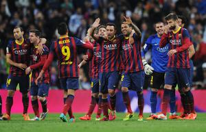 Barcelona players celebrate victory after the La Liga match between Real Madrid CF and FC Barcelona at the Bernabeu on March 23, 2014 in Madrid, Spain.  (Photo by Denis Doyle/Getty Images)