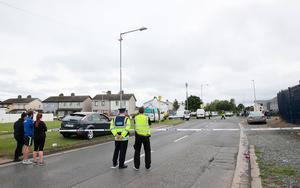 Gardai at the scene where man and a woman have been shot dead on Balbutcher Drive in Ballymun, Dublin.