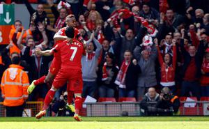 Liverpool's Raheem Sterling (top) celebrates his goal during the Barclays Premier League match at Anfield, Liverpool