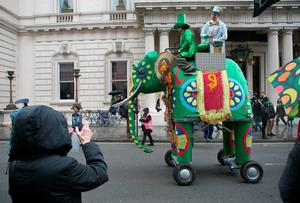 A bystander takes a photo of a elephant float at the Mayor of London's St Patrick's Day Parade and Festival in London. Daniel Leal-Olivas/PA Wire.