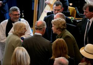 The Prince of Wales (centre) and Duchess of Cornwall (left) meet Former President of Ireland Mary McAleese (centre right) and her husband Martin (behind) as they attend a peace and reconciliation prayer service at St. Columba's Church in Drumcliffe on day two of a four day visit to Ireland. PRESS ASSOCIATION Photo. Picture date: Wednesday May 20, 2015. See PA story ROYAL Ireland. Photo credit should read: Colm Mahady/PA Wire