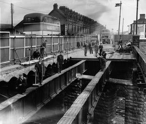 Workmen replace the old Donegall Road bridge spanning the Great Northern Railway main line.  17/3/1954