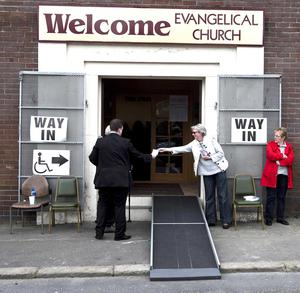 Voters take to the polls across Northern Ireland as voting begins in the 2016 Northern Ireland Assembly Election. Voters cast their vote in polling stations around Belfast. Pictured are canvassers outside Welcome evangelical church in the Woodvale area of West Belfast.   picture Mark Marlow/pacemaker press