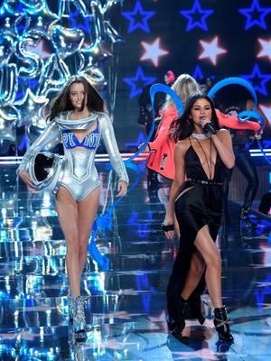 NEW YORK, NY - NOVEMBER 10:  Model Megan Puleri from Ohio walks the runway while singer Selena Gomez performs during the 2015 Victoria's Secret Fashion Show at Lexington Avenue Armory on November 10, 2015 in New York City.  (Photo by Jamie McCarthy/Getty Images)