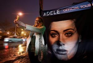 An Adele fan takes a selfie outside the SSE Arena on February 29, 2016 in Belfast, Northern Ireland. (Photo by Charles McQuillan/Getty Images)