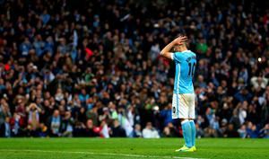 MANCHESTER, ENGLAND - APRIL 12:  Sergio Aguero of Manchester City reacts as he misses a penalty kick during the UEFA Champions League quarter final second leg match between Manchester City FC and Paris Saint-Germain at the Etihad Stadium on April 12, 2016 in Manchester, United Kingdom.  (Photo by Clive Brunskill/Getty Images)