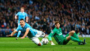 MANCHESTER, ENGLAND - APRIL 12:  Sergio Aguero of Manchester City is fouled by goalkeeper Kevin Trapp of Paris Saint-Germain for a penalty during the UEFA Champions League quarter final second leg match between Manchester City FC and Paris Saint-Germain at the Etihad Stadium on April 12, 2016 in Manchester, United Kingdom.  (Photo by Clive Brunskill/Getty Images)