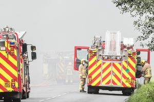 Fire crews at the scene of a large fire at Foyle Port outside Derry. Picture Martin McKeown. 29.07.20
