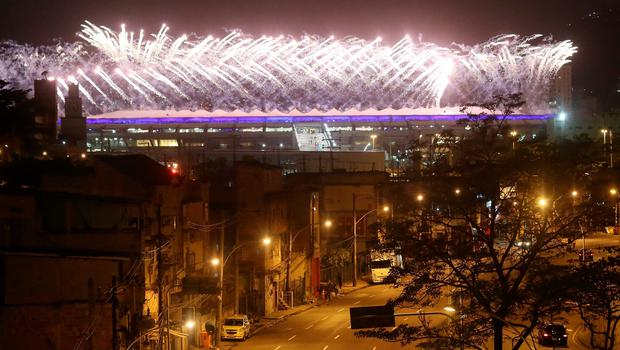 RIO DE JANEIRO, BRAZIL - SEPTEMBER 07:  Fireworks explode behind the Metro-Mangueira favela community during the Opening Ceremony of the Rio 2016 Paralympic Games at Maracana Stadium on September 7, 2016 in Rio de Janeiro, Brazil.  (Photo by Mario Tama/Getty Images) *** BESTPIX ***