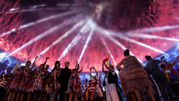 RIO DE JANEIRO, BRAZIL - SEPTEMBER 07:  Atheletes and performers enjoy fireworks during the Opening Ceremony of the Rio 2016 Paralympic Games at Maracana Stadium on September 7, 2016 in Rio de Janeiro, Brazil.  (Photo by Buda Mendes/Getty Images) *** BESTPIX ***