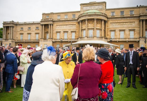 The Queen greeting guests during a garden party at Buckingham Palace (PA)